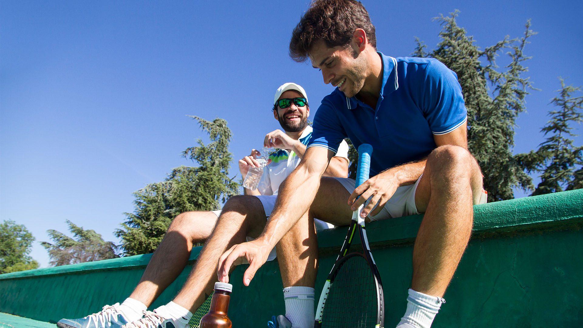 Two male tennis players taking a break